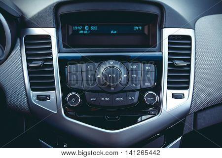 Car dashboard. Radio closeup. Modern CD player