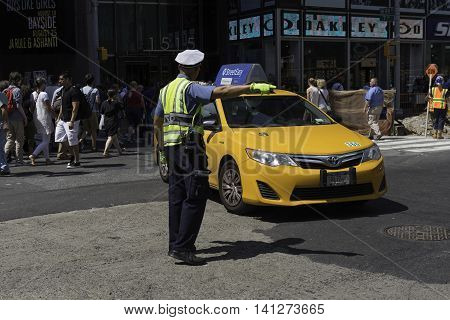 New York NY USA --Aug 3 2016-- A police officer directs traffic in Midtown Manhattan. Editorial Use Only.