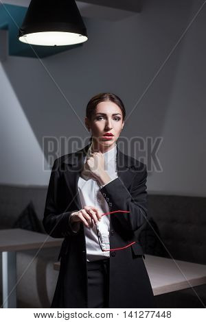 Businesswoman Dressed In Suit And With Red Lips And Glasses;