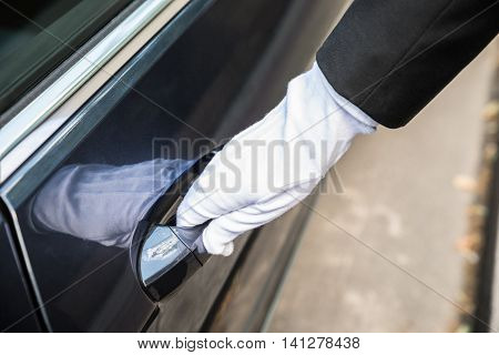 Close-up Of A Male Chauffeur Pulling A Car's Door Handle