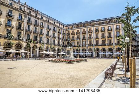 GIRONA SPAIN - JULY 6 2016: Independence Square (Plaza de la Independencia) in the old town of Girona Spain