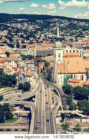 Saint Martin's cathedral and bridge SNP in Bratislava Slovak republic. Architectural theme. Retro photo filter. Cultural heritage. Travel destination. Beautiful place. Vertical composition.