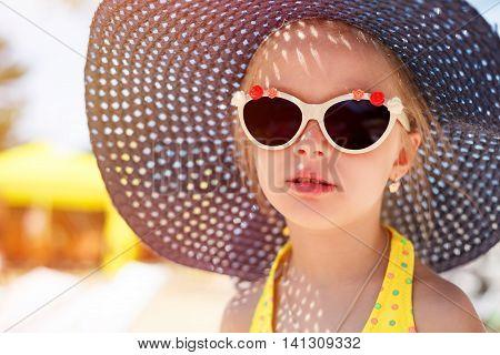 Cute Little Girl In Fashionable Hat. Portrait Of A Kid.