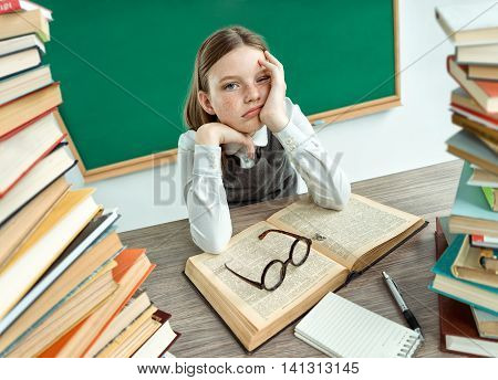 Sleepy exhausted or bored young student. Photo of schoolgirl creative concept with Back to school theme