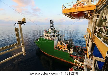 Supply boat transfer cargo to oil and gas industry and moving cargo from the boat to the platform, boat waiting transfer cargo and crews between oil and gas platform and crews boat operation in boat. poster
