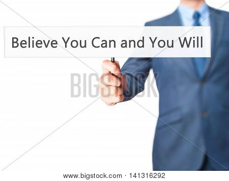 Believe You Can And You Will - Businessman Hand Holding Sign