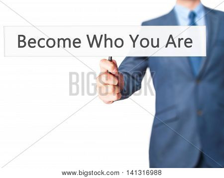 Become Who You Are - Businessman Hand Holding Sign