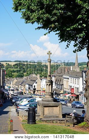 BURFORD, UNITED KINGDOM - JULY 20, 2016 - View of shops and businesses along The Hill shopping street with the war memorial in the foreground Burford Oxfordshire England UK Western Europe, July 20, 2016.