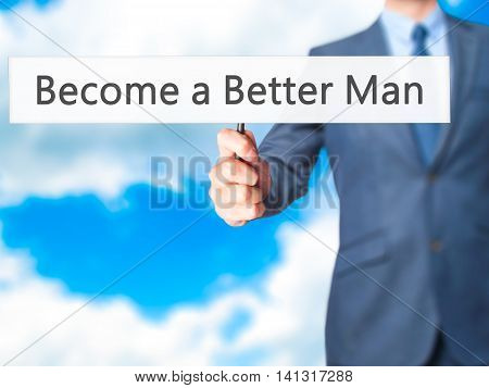 Become A Better Man - Businessman Hand Holding Sign