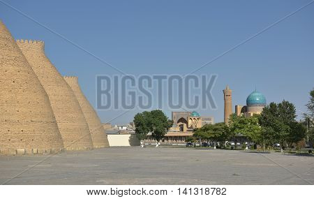 Ark is the ancient fortress (IX - X century) in Bukhara. The Ark fortress towering over the old Registan square and was a symbol of greatness power and strength in the Emirate of Bukhara.
