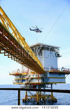 helicopter parking landing on offshore platform, Helicopter transfer crews or passenger to work in offshore oil and gas industry, air transportation for support passenger, ground service in airport.