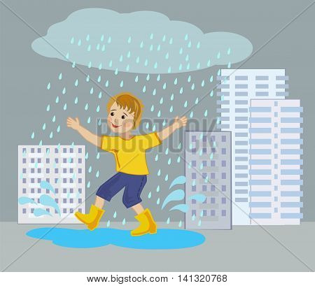 Joyful boy runs through the puddles under the summer rain in the city