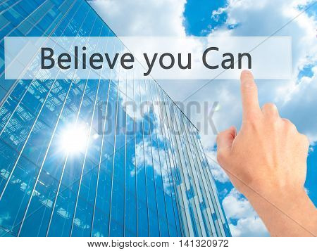 Believe You Can - Hand Pressing A Button On Blurred Background Concept On Visual Screen.