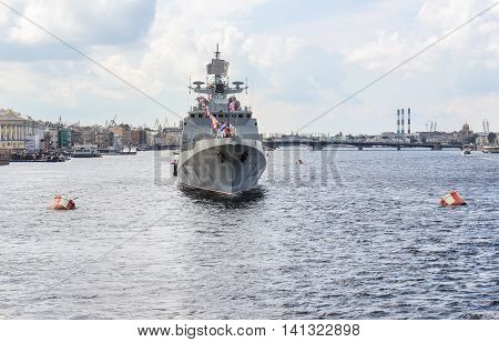 St. Petersburg, Russia - 31 July, A large warship in the wake of the river, 31 July, 2016. Festive parade of warships on the Neva River in St. Petersburg.