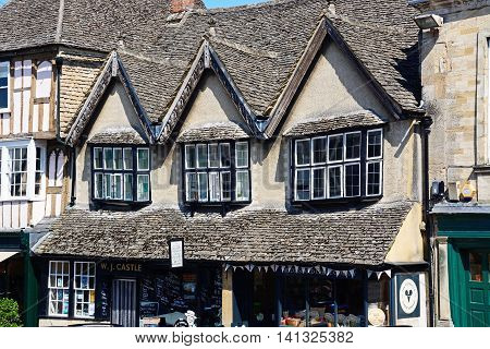 BURFORD, UNITED KINGDOM - JULY 20, 2016 - Architecture detail above The Cotswold Cheese Company shop and Butchers shop along The Hill shopping street Burford Oxfordshire England UK Western Europe, July 20, 2016.