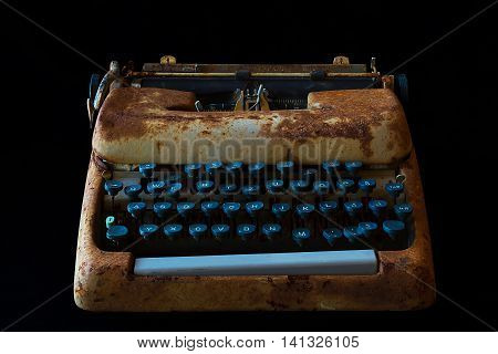 Typewriter Waiting for Inspiration. Vintage Rusty Typewriter Machine. Journalist Equipment. Typewriter Isolated on Black Background.