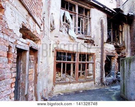 Destroyed house as a symbol of devastation, desolation, destruction, loss, or war