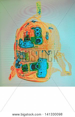 the photographer's backpack under a X-ray. check of baggage at the airport.Camera and lenses. check of baggage at the airport.