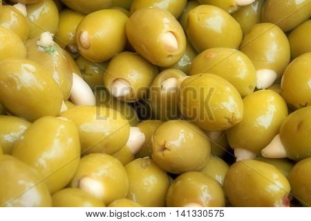 Green olives with almonds, marinated with basil