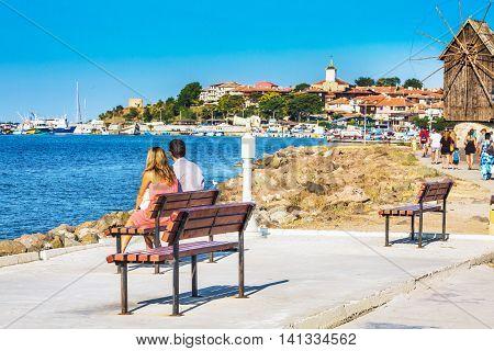 Nesebar, Bulgaria - July 25, 2016: Couple looking at old town panorama in Nessebar or Nesebar in Bulgaria, Black sea