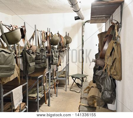 SATOV CZECH REPUBLIC - JULY 29 2016: Guard bedroom with bunk beds and equipments in army infantry blockhouse Zahrada near Satov village