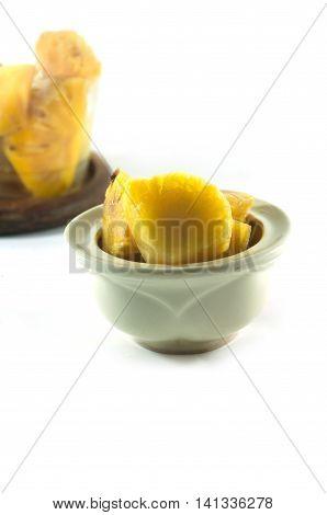 Heap of rancid pineapple chunks on white background