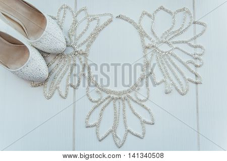 bridal wedding accessories on dressing table with shoes
