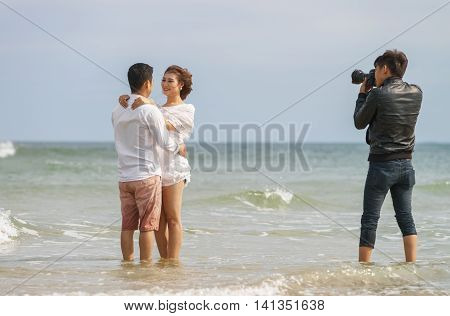 Young Couple Hugging Each Other In China Beach In Danang