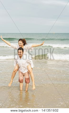 Young Couple Posing In China Beach In Danang In Vietnam