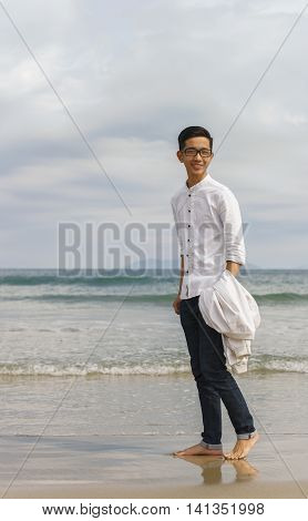 Young Fellow At China Beach Of Danang In Vietnam
