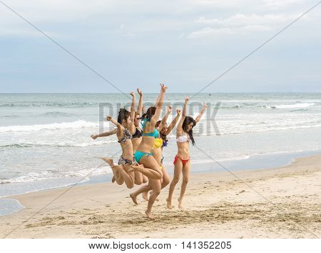 Young Girls Jumping At China Beach In Danang Of Vietnam