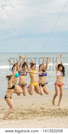 Young Girls Jumping At China Beach Of Danang In Vietnam