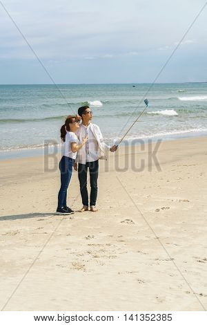 Young People Use Selfie Stick At China Beach Danang