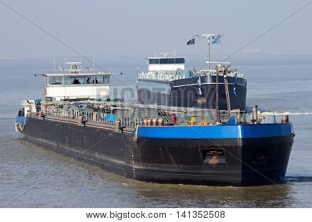 Tanker barges on the Scheldt river near Antwerp.
