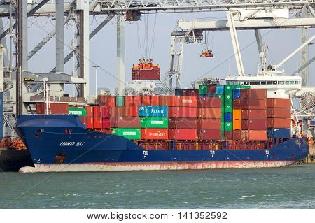 ROTTERDAM NETHERLANDS - MAR 16 2016: Container ship Conmar Bay moored at a container terminal in the Port of Rotterdam.