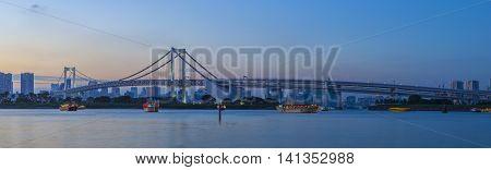 beautiful dusky sky city scape of rainbow bridge important landmark and town transportation in odaiba tokyo japan