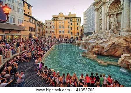 Tourists At Trevi Fountain In Rome In Italy