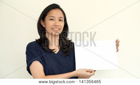 South East Asian Girl Casually Holding While Sign For Copy Space