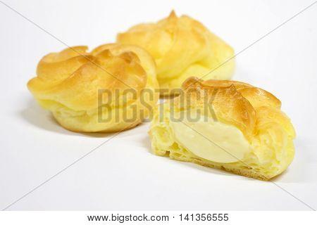 Dessert snacks Eclair reveals cream on a white background