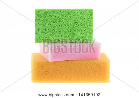 Stack of clean super absorbent cellulose sponge, dish washing sponge with scrub and multi purpose sponge isolated on white background