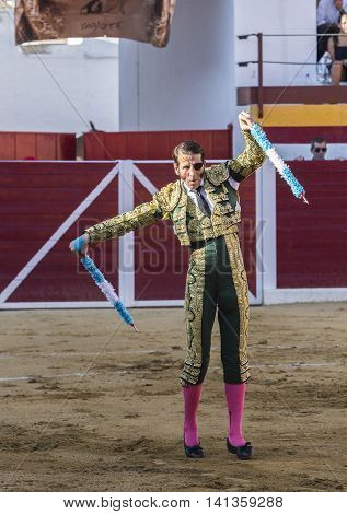 Sabiote Spain - August 23 2014: The Spanish Bullfighter Juan Jose Padilla putting flags during a bullfight in the Bullring of Sabiote Spain