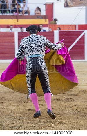 Sabiote Spain - August 23 2014: Bullfighter with the capote or cape Spain Sabiote Spain