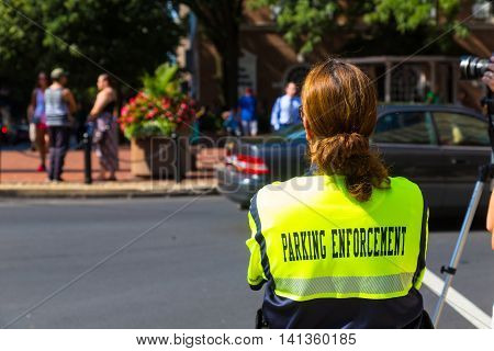 Lancaster PA - August 4 2016: A parking enforcement officer in the City of Lancaster.