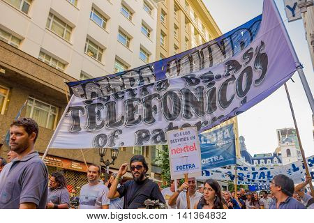 BUENOS AIRES, ARGENTINA - MAY 02, 2016: unidentified people protest against mass layoffs on public phone companies.