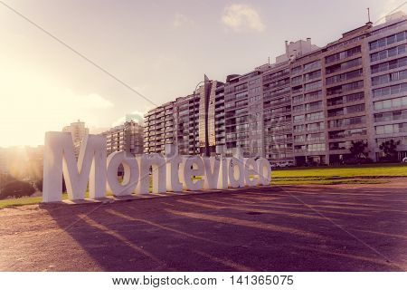 MONTEVIDEO, URUGUAY - MAY 04, 2016: montevideo sign with nice sunset light proyecting shadow on the ground.