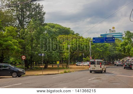 PORTO ALEGRE, BRAZIL - MAY 06, 2016: normal traffic street in one of the sides of a city park.