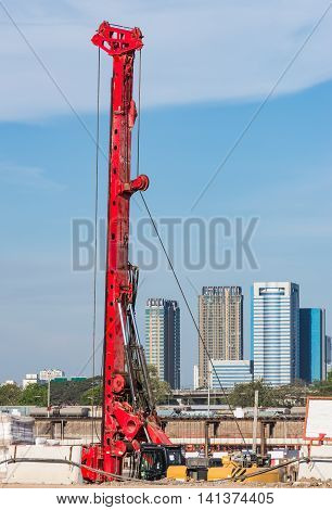 Modern high drill machine in the constrction site of urban areaThailand.