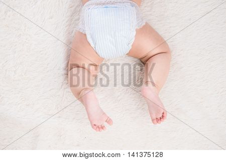 Birthmark on Asian baby girl legs for white background