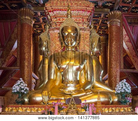 Golden Buddha statue is squat in four angle of the Thai church.