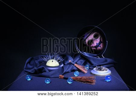 items for magic and witchcraft exorcism ritual on a black background